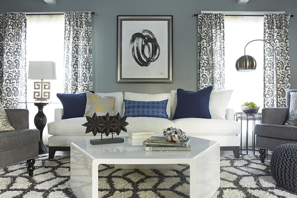 Гостиная в  цветах:   Белый, Светло-серый, Серый, Фиолетовый.  Гостиная в  стиле:   Минимализм.