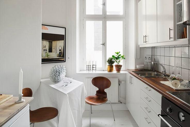 Кухня в цветах: черный, серый, белый, темно-коричневый. Кухня в стиле скандинавский стиль.