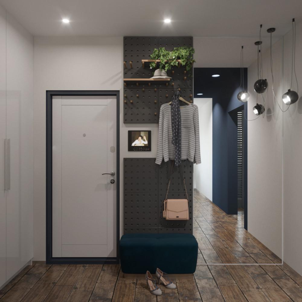 В прихожей вдоль стены разместился большой шкаф (до потолка) для верхней одежды членов семьи. Зеркало и панели-вешалка.