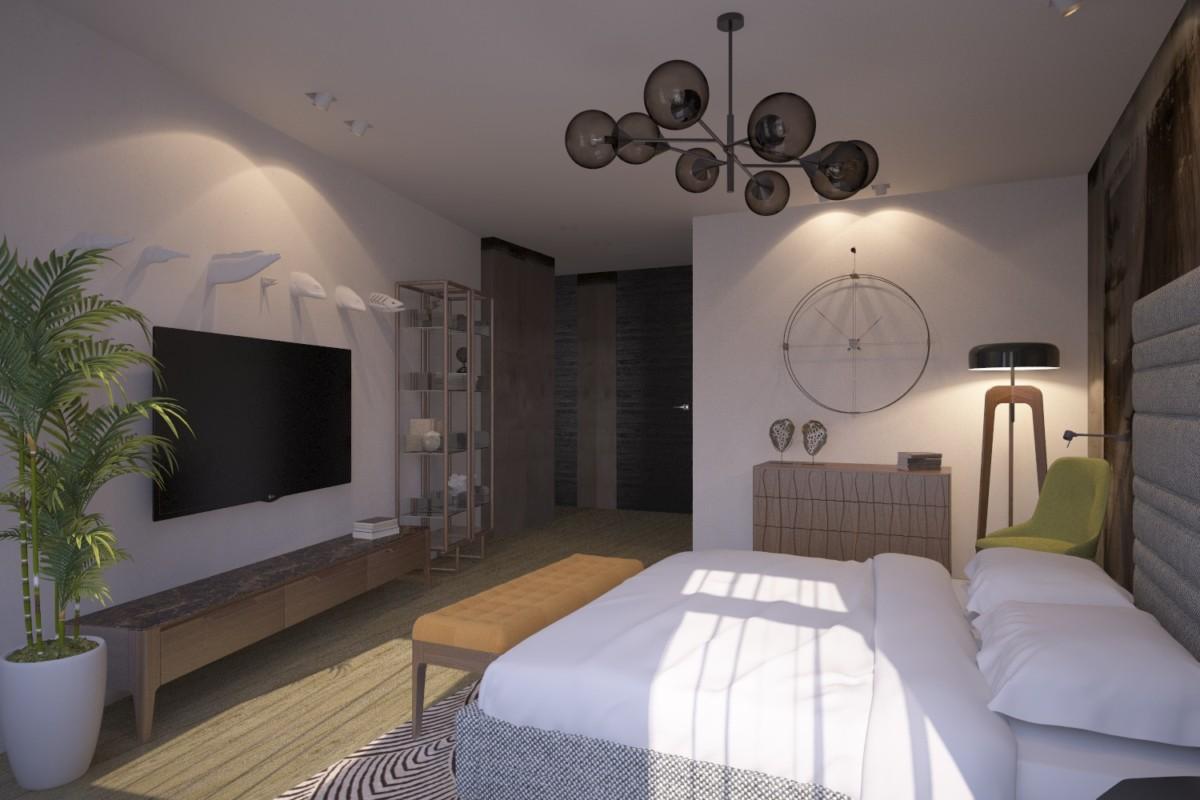 Белый гипсовый декор в виде рыб на стене у кровати не спорит с принтом напротив, а лишь добавляет пластики.