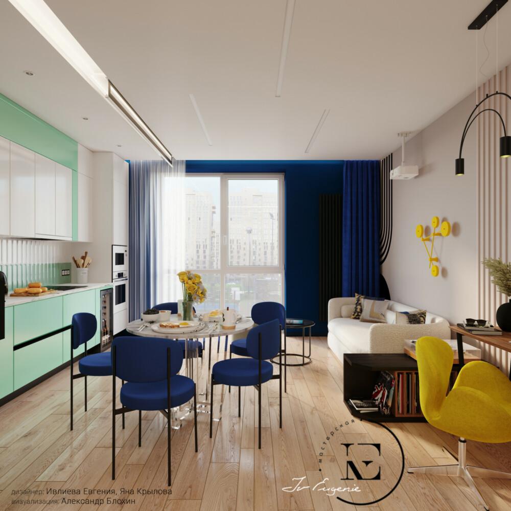 Мы видим кухню-гостиную в стиле Soleray. За счет выкраса стены с окном в синий цвет, кажется, что поток уличного света увеличился в несколько раз. В том же оттенке подобраны портьеры и стулья в обеденной группе. По просьбе хозяина-меломана было обустроено место для хранения пластинок и проигрывателя. С помощью графики на стене подчеркивается индивидуальность проекта. Ярким элементом декора выделяется желтое кресло у рабочего стола и инсталяция на стене.